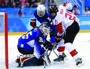 Goalie Maddie Rooney (35), of the United States, deflects a shot by Haley Irwin (21), of Canada, during the second period of the women's gold medal hockey game at the 2018 Winter Olympics in Gangneung, South Korea, Thursday. AP NEWSWIRE
