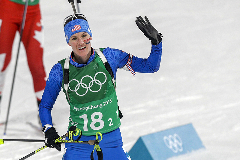 Clare Egan waves to cheering fans after her race during the women's 4x6-kilometer biathlon relay on Thursday.
