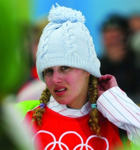 In this Friday, Feb. 17, 2006 file photo, silver medallist Lindsey Jacobellis, of the United States, reacts prior to the flower ceremony of the Women's Snowboard Cross competition at the Turin 2006 Winter Olympic Games in Bardonecchia, Italy. AP NEWSWIRE