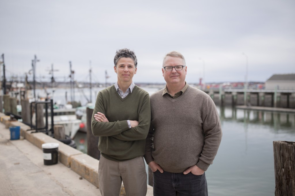 Julie Rosenbach, South Portland's sustainability director, and Troy Moon, Portland's sustainability coordinator, on Portland's waterfront. Both are involved in efforts to make the cities more resilient as the climate changes.