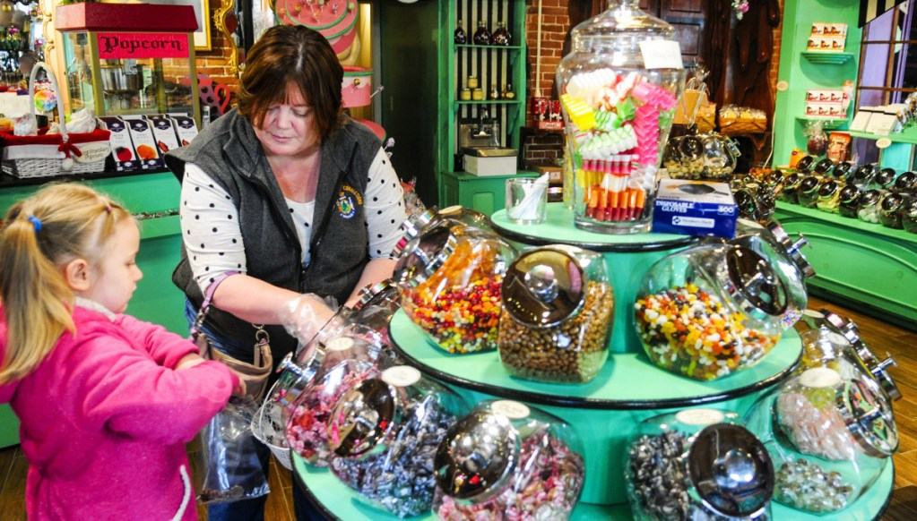Jaylynn Tenney, 6, and her grandmother Angie Newhouse shop for candy at Scrummy Afters last year on Water Street in downtown Hallowell.