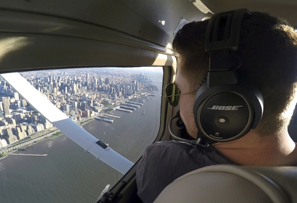 Aaron Ludomirski, a certified flight instructor for Infinity Flight Group, flies over the Hudson River in New York. Major U.S. airlines are hiring pilots at a rate not seen since before 9/11, and that is encouraging more young people to consider a career in the cockpit.