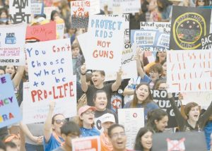 """DEMONSTRATORS CHEER during a """"March for Our Lives"""" protest for gun legislation and school safety Saturday in Washington, D.C."""