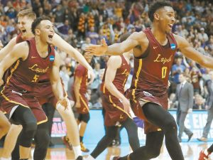 FINAL FOUR BOUND: Loyola-Chicago players celebrate after winning a regional final NCAA college basketball tournament game against Kansas State on Saturday in Atlanta. Michigan, Kansas and Villanova are also heading to the Final Four in San Antonio.