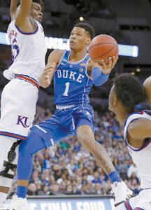 DUKE'S Trevon Duval (1) shoots as Kansas' Udoka Azubuike, left, and Marcus Garrett defend during a regional final game in the NCAA men's college basketball tournament in Omaha, Neb.