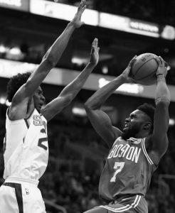 BOSTON CELTICS guard Jaylen Brown (7) tries to drive past Phoenix Suns guard Josh Jackson, left, during the first half of an NBA basketball game Monday in Phoenix.