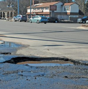 """""""IT'S POTHOLE SEASON AT COOK'S CORNER,"""" says Mark Royall, who captured this photo of a pothole at the Brunswick strip mall. """"This one is destined to damage autos."""""""