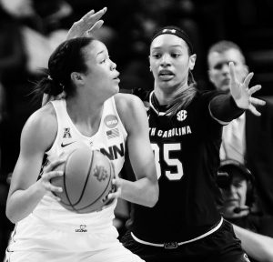 SOUTH CAROLINA'S Alexis Jennings (35) defends against Connecticut's Napheesa Collier, left, during the first half of a regional final at the a women's NCAA college basketball tournament on Monday in Albany, N.Y. UConn rolled to a 94-65 win.