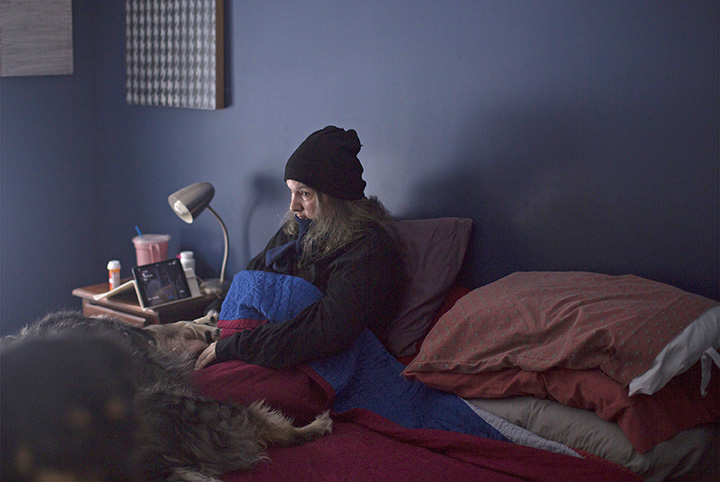 Amy Stacey Curtis, 47, remains largely bedridden at her home in Lyman. Known for her solo biennial installations at abandoned mills across Maine – such as her 2014 version, below – the artist has suffered a mental break that has left her disabled and struggling to find answers.