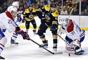 Rick Nash of the Boston Bruins battles Montreal's Antti Niemi for the puck during the second period of a NHL game in Boston on Saturday, March 3, 2018. AP NEWSWIRE/Michael Dwyer