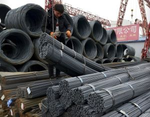 """A worker loads steel products onto a vehicle at a steel market in Fuyang in central China's Anhui province Friday, March 2, 2018. China has expressed """"grave concern"""" about a U.S. trade policy report that pledges to pressure Beijing but had no immediate response to President Donald Trump's plan to hike tariffs on steel and aluminum. AP NEWSWIRE"""