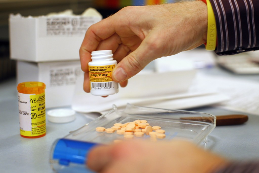 A Boston pharmacist fills a Suboxone prescription in 2013. Legislation approved by both chambers of the Maine Legislature would allocate $6.6 million annually for medication-assisted treatment of uninsured drug users.