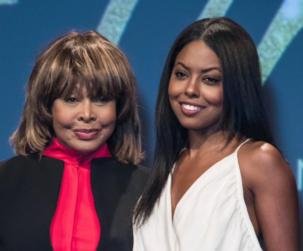 """Tina Turner, left, poses with actress Adrienne Warren, who plays Turner in the musical """"Tina."""" Turner attended opening night Tuesday and joined the cast on stage for the curtain call."""