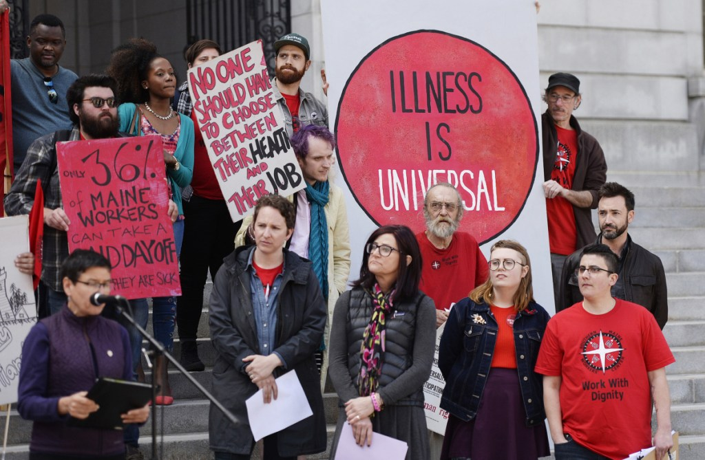 Supporters of a proposed ordinance mandating paid sick time for workers in Portland rally Tuesday outside City Hall. A business owner says it's not the government's job to dictate benefits.