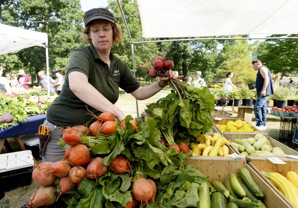 Carolyn Snell of Snell Farm puts out beets at Deering Oaks farmers' market in 2016. The market moves outdoors for the season beginning this weekend.