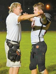 DON CRANE attends to Brunswick High School football player Jack Harvey during a football game in 2017. Crane, employed by Mid Coast Hospital, is the athletic trainer at the school.
