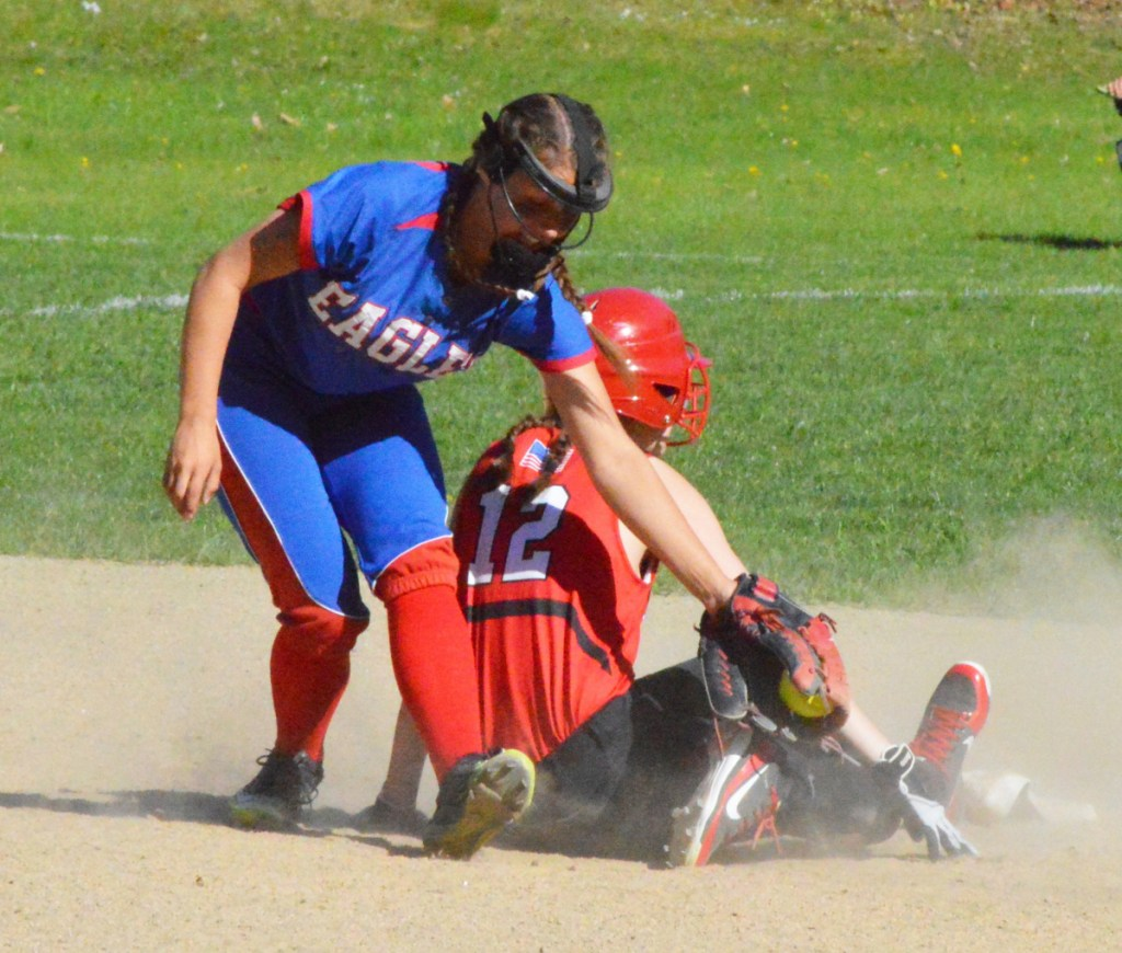 Mt. Ararat shortstop Zoe Stilphen is late with the tag as Amy Kunzinger of Camden Hills slides in safely at second base. Mt. Ararat won in eighth innings, 13-12.