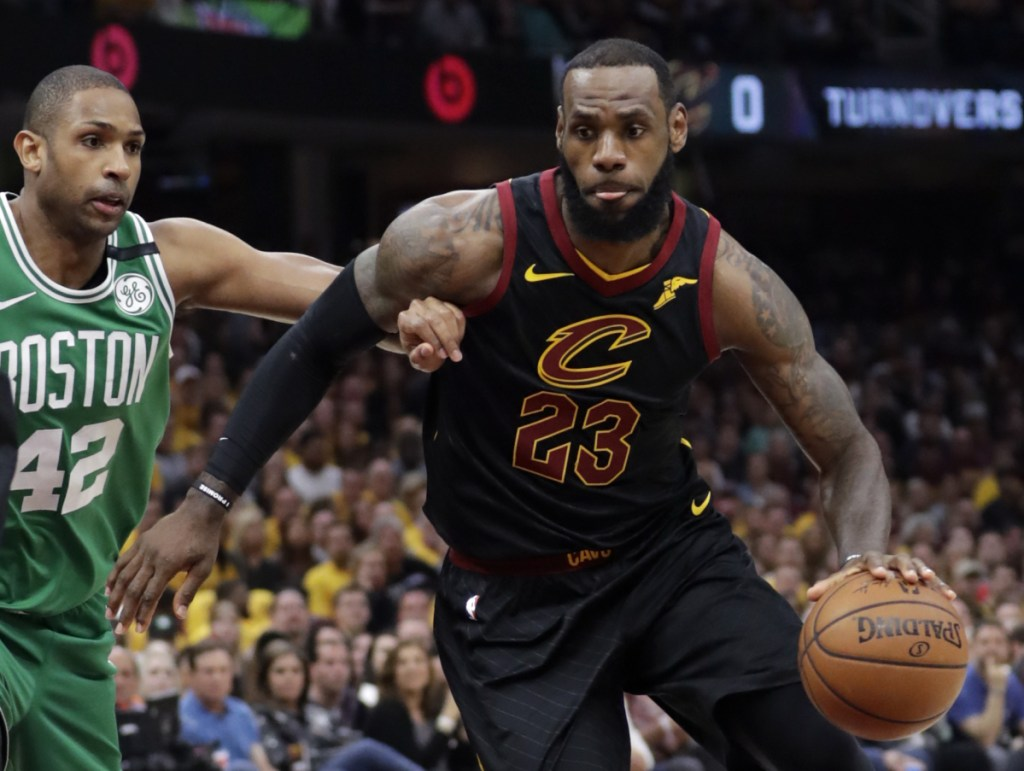 Cleveland's LeBron James drives past Boston's Al Horford in the first half of Game 4 of the Eastern Conference finals on Monday in Cleveland. The Cavaliers won 111-102 to tie the series at 2-2.