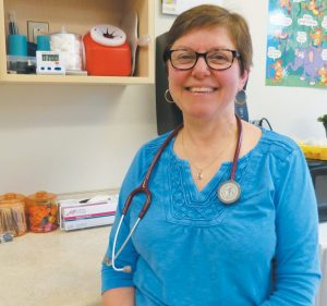 "LINDA MORRIS, the school nurse at Harriet Beecher Stowe Elementary School in Brunswick, said starting out ""there was a lot to learn."" DARCIE MOORE / THE TIMES RECORD"