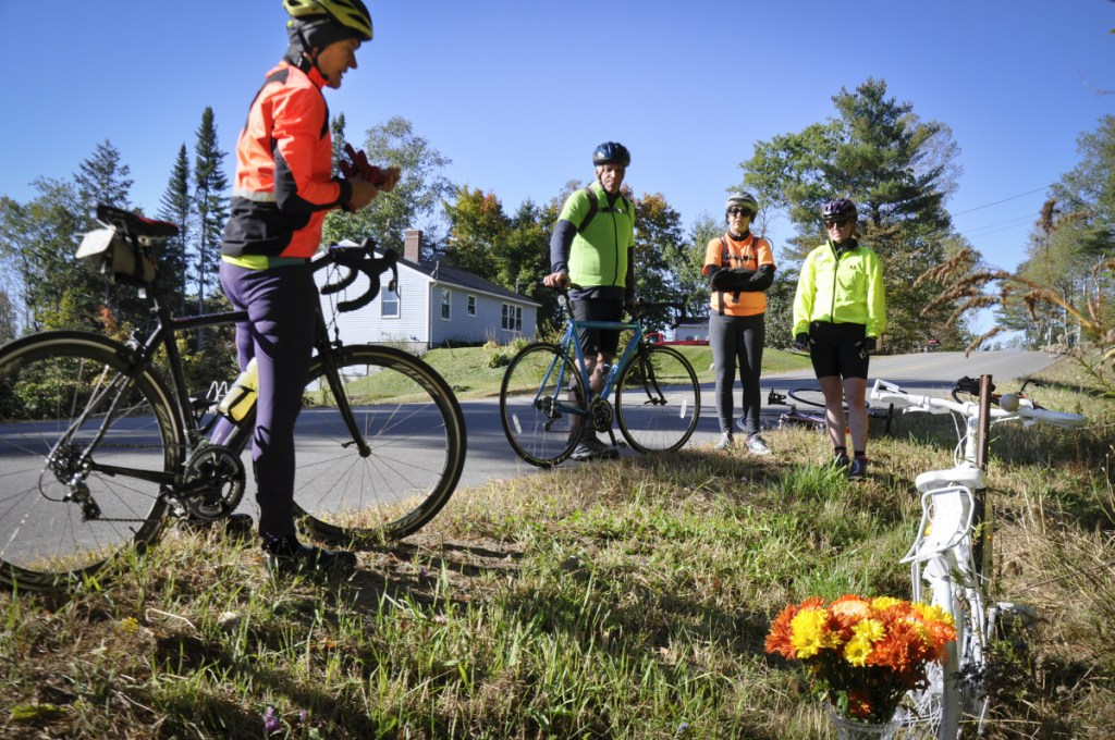 Bicycle Coalition of Maine Executive Director Nancy Grant, left, and other bicyclists pay their respects to Dr. Carol Eckert in October 2017.