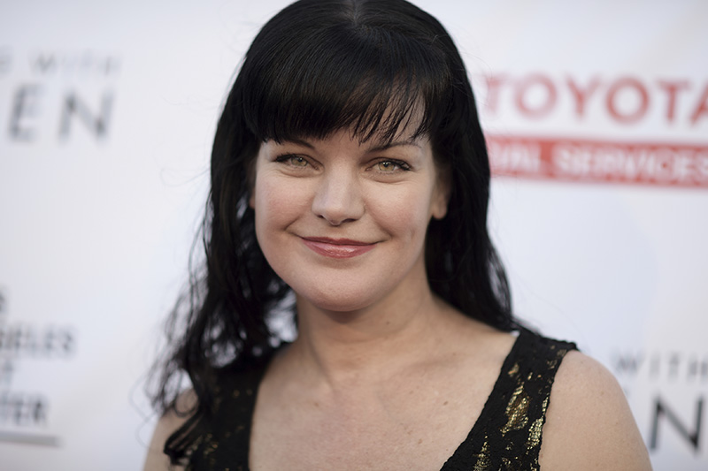 "Pauley Perrette attends ""An Evening with Women"" held at the Hollywood Palladium in Los Angeles in 2016."