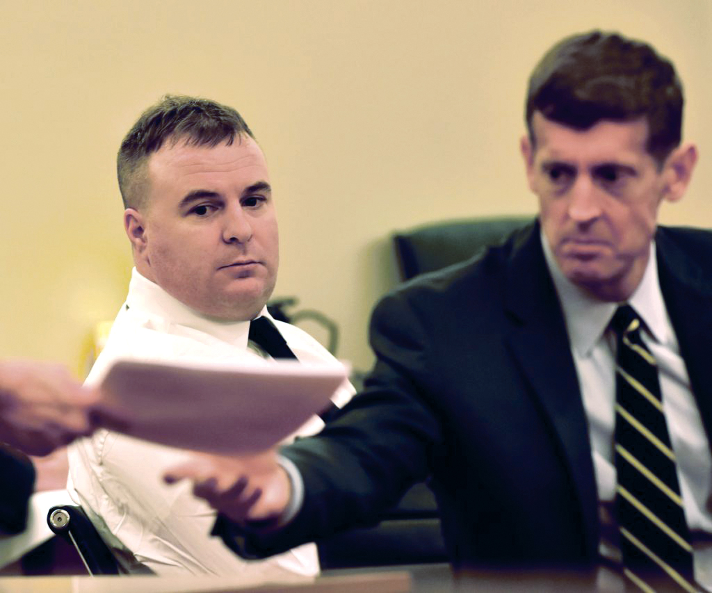 Defendant Jeremy Clement, left, looks on as his attorney, Walter McKee, receives a court document during the first day of his jury trial in Augusta Superior Court on Monday.
