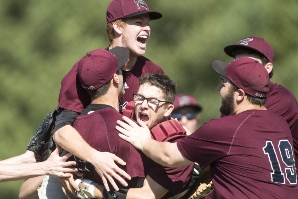 Members of the Richmond baseball team celebrate after Zach Small tossed a no-hitter in an 11-0 victory over Fort Fairfield in the Class D state championship game Saturday at Mansfield Stadium in Bangor.