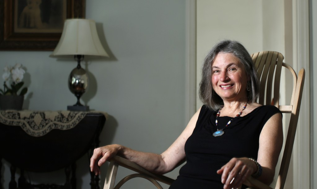 """Linda Aldrich relaxes at her Portland home. The city's new poet laureate was inaugurated Tuesday to the honorary, volunteer position, replacing Gibson Fay-Leblanc. """"I would like to bring poetry more into the lives of people who live here, no matter who they are,"""" she said."""