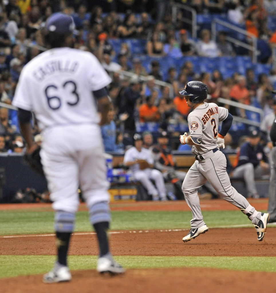 Tampa Bay reliever Diego Castillo watches as Houston's Alex Bregman circles the bases after hitting a two-run home run in the sixth inning Friday night in St. Petersburg, Fla. The Rays beat the Astros 3-2, ending Houston's 11-game road winning streak.