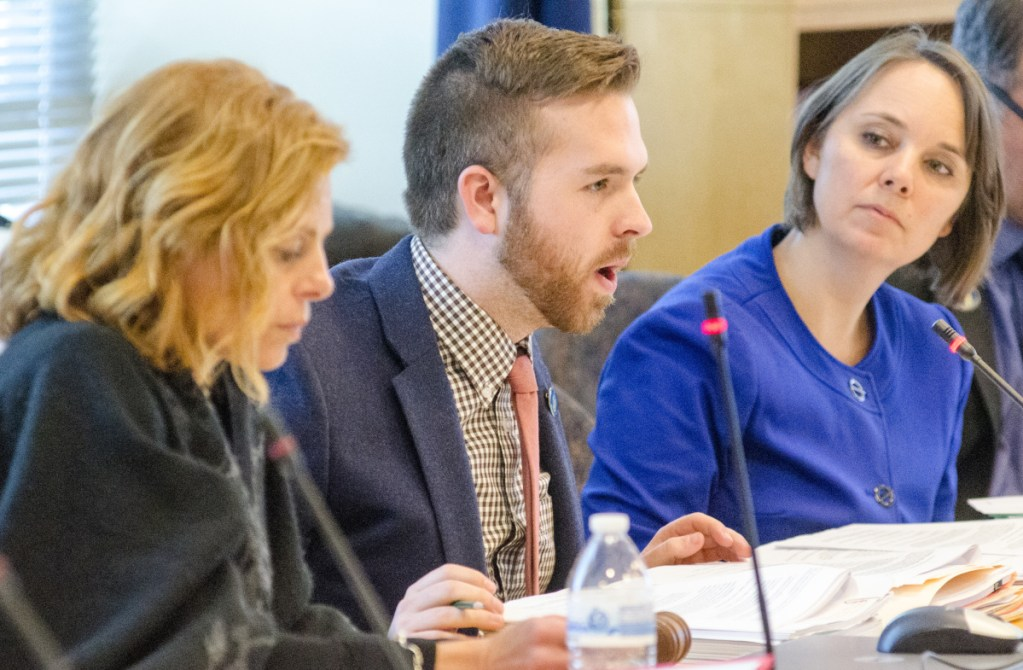 Sen. Amy Volk, R-Scarborough, left, Rep. Ryan M. Fecteau, D-Biddeford, and Sen. Shenna Bellows, D-Manchester, take part March 6 in a meeting of the Labor, Commerce, Research and Economic Development Committee. Bellows now says she is concerned about the labor department's plans to roll out the next phase of the ReEmployME unemployment insurance system.