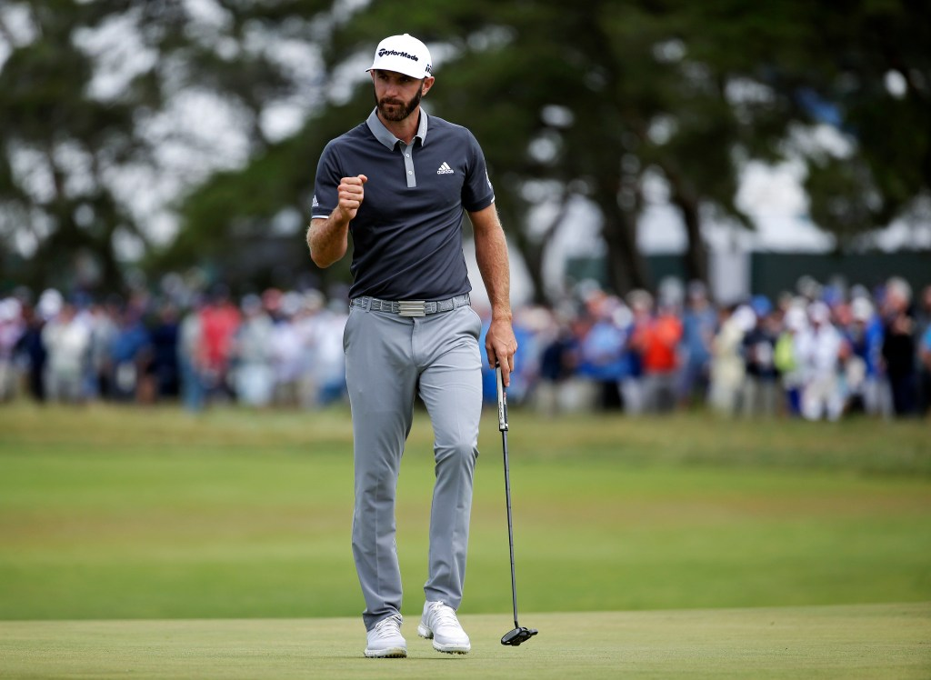 Dustin Johnson reacts after making a putt for birdie on the fourth green during the second round of the U.S. Open on Friday in Southampton, N.Y. Johnson has a four-shot lead after the second round.