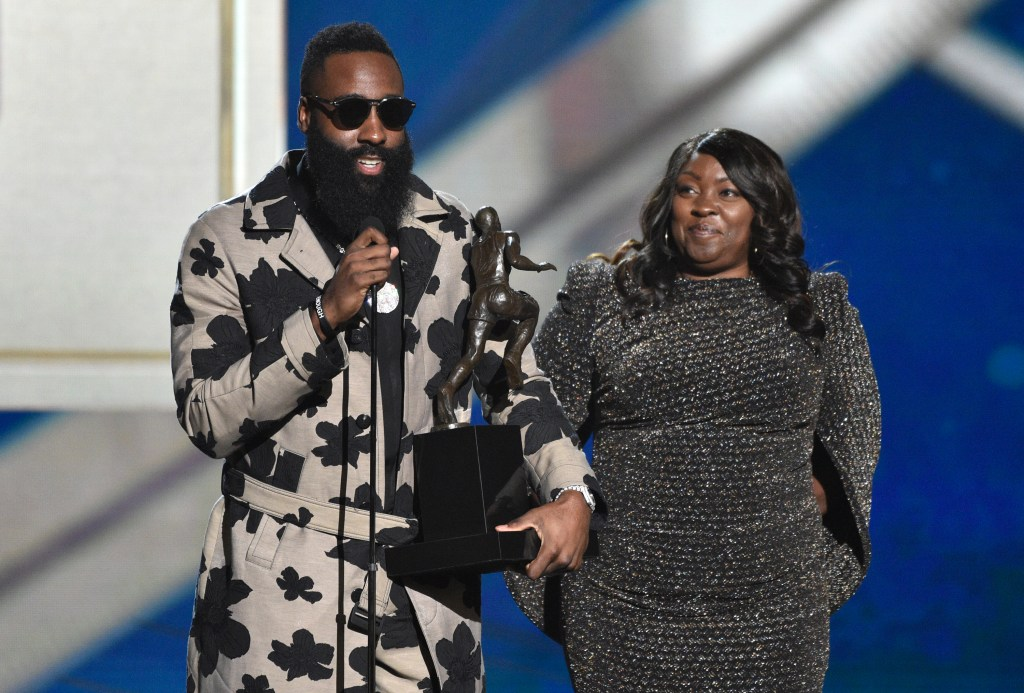 NBA player James Hardin, of the Houston Rockets, left, accepts the most valuable player award as his mother Monja Willis looks on at the NBA Awards on Monday, June 25, 2018, at the Barker Hangar in Santa Monica, Calif.