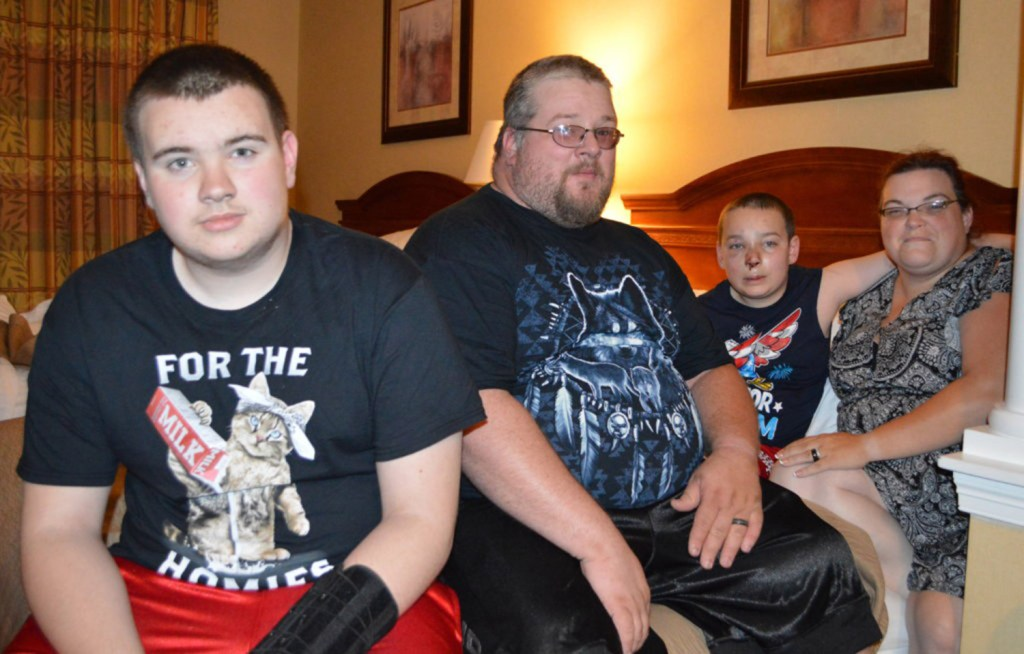 The Mosher family escaped their burning home Tuesday night on Main Street in Livermore Falls. From left are Collin, 13, Robert, 35, Brayden, 11, and Amy, also 35.