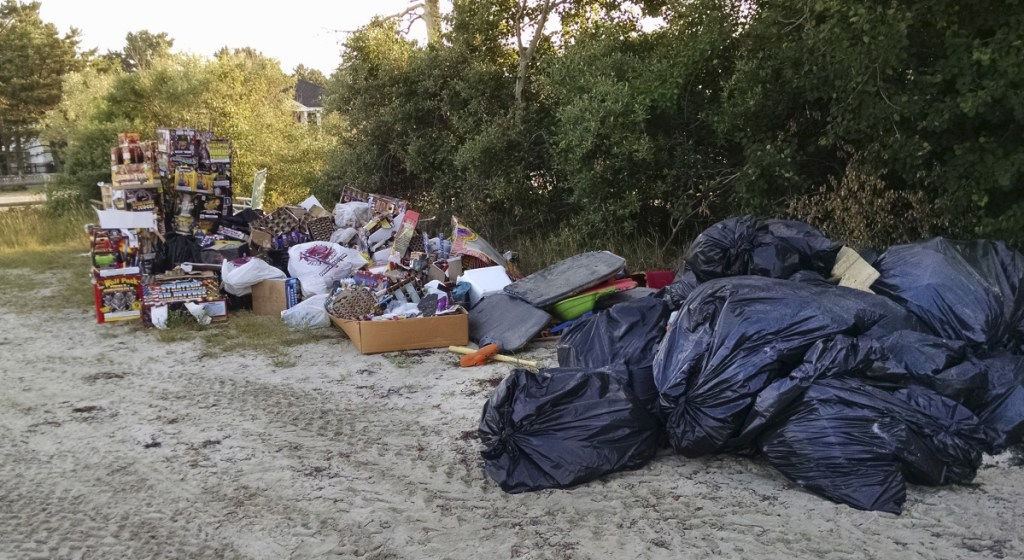 Debris gathered by town workers on the day after the Fourth of July, much of it fireworks packaging and remnants, sits along Pine Point Beach in Scarborough. Beach neighbor Karen D'Andrea posted photos online and railed against the mess, drawing scores of comments.