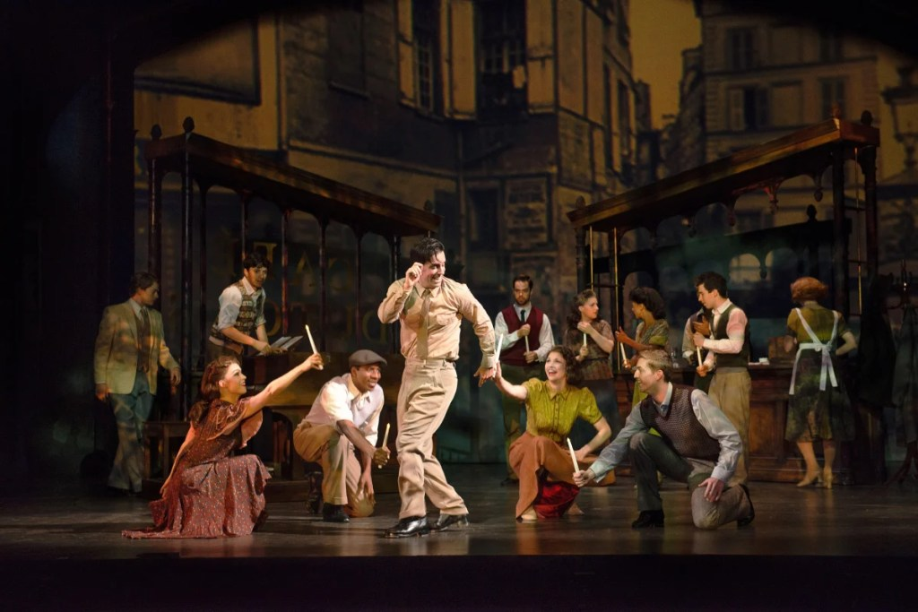 """Clyde Alves and the cast in one of the big production numbers of """"An American in Paris."""""""