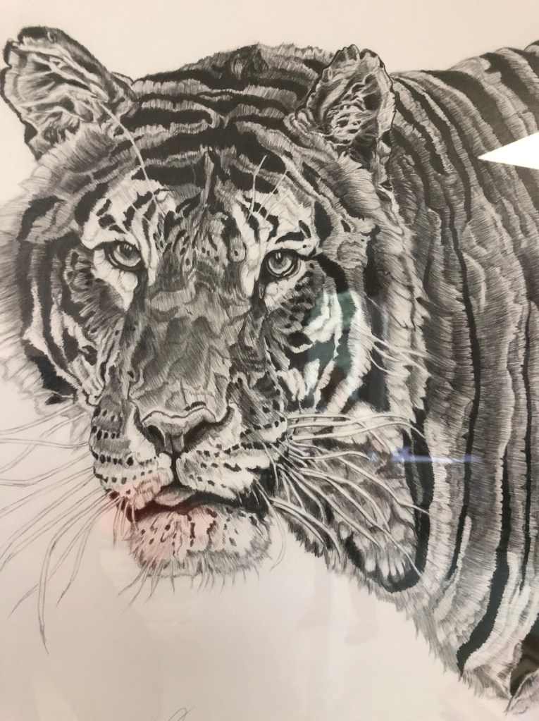 "Neal Caron of Oakland had several works on display, including  a graphite drawing of a tiger. He said his artwork and poetry give him an escape from memories of his time as a Navy medic. ""I lose myself in the art and in the words, and it is therapy for me, and I can see how it can be for others,"" he says."