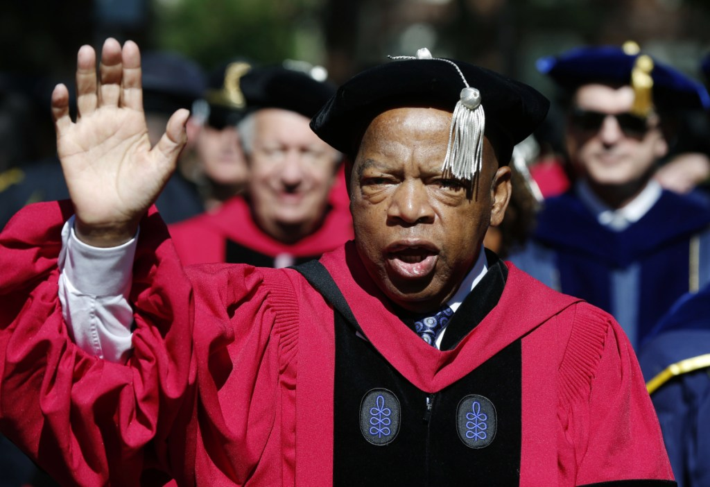 U.S. Rep. John Lewis walks in a procession during Harvard University commencement exercises in Cambridge, Mass. The civil rights icon was hospitalized for undisclosed reasons. Lewis was released Sunday night.