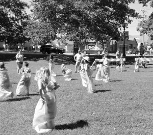"""POTATO SACK RACES at the Rotary Club of Brunswick's """"Fun and Games on the Mall"""" on July 4. GEORGE MALING / COURTESY OF PHOTO OF SACK RACE BY GEORGE MALING"""