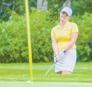 BAILEY PLOURDE watches a chip shot approach the green during the final round of the Maine Women's Amateur on Wednesday at Rockland Golf Club. Plourde shot her second straight 78 and won the tournament at 13-over par. JOE PHELAN / KENNEBEC JOURNAL