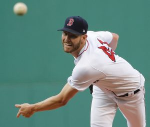 BOSTON RED SOX starting pitcher Chris Sale watches a throw during the first inning of the team's baseball game against the Texas Rangers on Wednesday in Boston. Sale tossed seven shutout innings as the Sox won, 4-2. THE ASSOCAITED PRESS