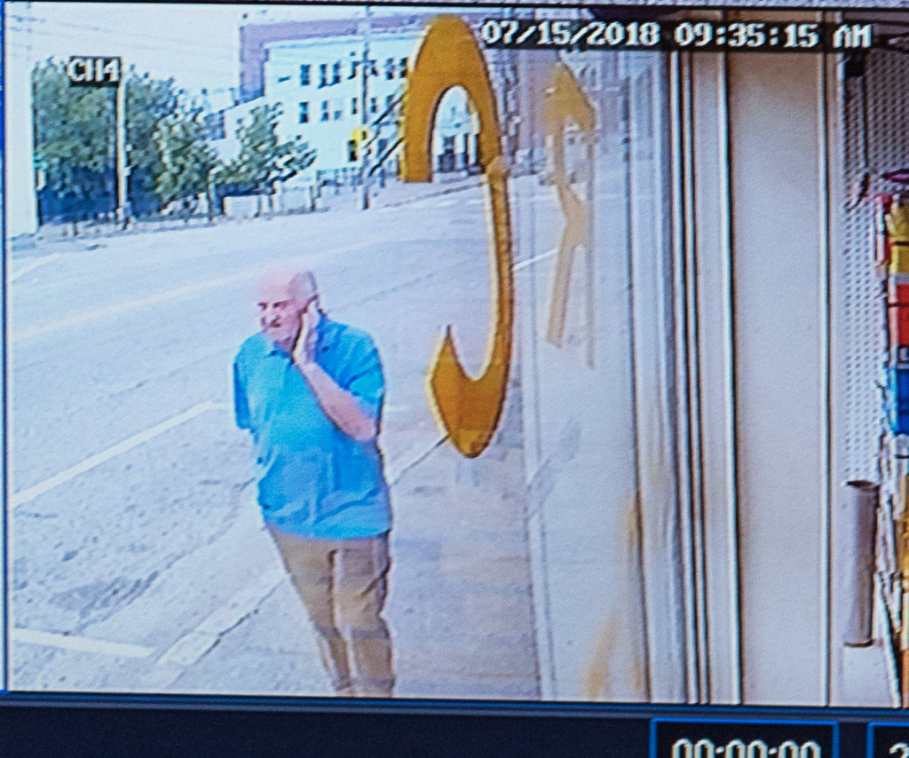 In this surveillance video from a store on Sabattus Street, Albert Flick paces back and forth on the sidewalk moments before Kimberly Dobbie was stabbed to death Sunday morning in Lewiston.