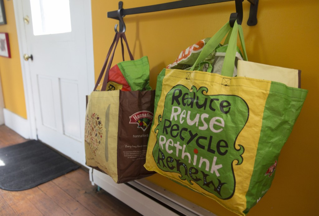 Reusable shopping bags hang by the door at Christine Burns Rudalevige's home.