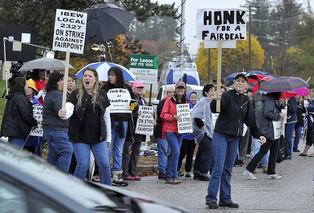 Striking FairPoint workers picket at the corner of Davis Farm Road and Riverside Street in Portland in October 2014. FairPoint's successor, Consolidated Communications, and the phone workers' union are now trying to reach a new contract agreement by midnight Saturday.