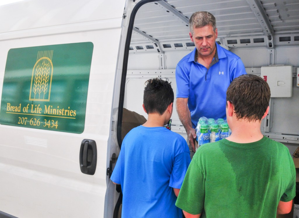David Austin delivers donated food to the Greater Augusta Boys and Girls Club on Friday in Augusta. Austin has a volunteer job driving the van for Bread of Life Ministries, delivering donated food to charity groups around Augusta.
