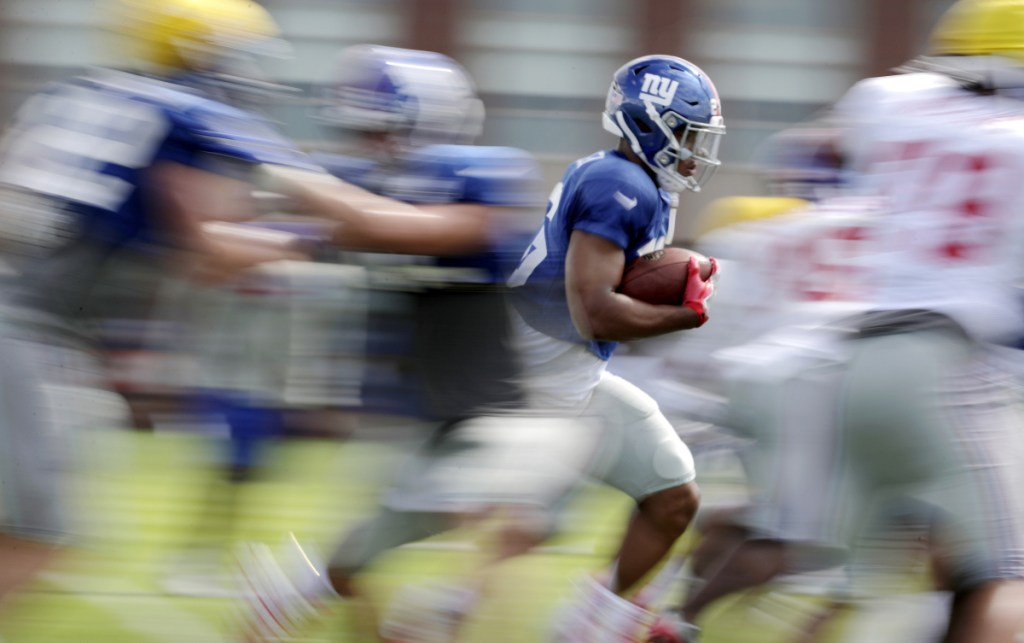 Saquon Barkley was a blur running past defenders at Penn State, and has been doing the same as the No. 2 overall draft choice in training camp for the New York Giants.