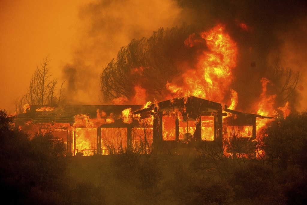 A home burns as the River Fire rages near Finley, Calif., on July 30.