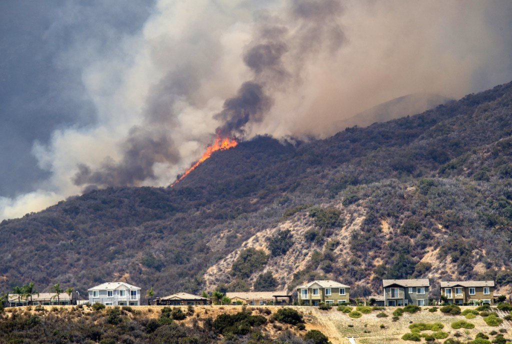 Forrest Clark, below, was charged Thursday with setting the Holy Fire near Lake Elsinore, California, on Monday.