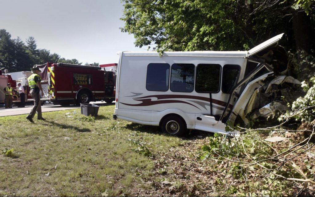 New Hampshire State Police investigate after a van crashed on Interstate 95 on Friday in Greenland, N.H.