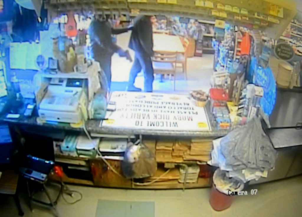 Surveillance video shows an armed robber holding up Moby Dick Variety Store in Old Orchard Beach in April. It was one of more than a dozen crimes being investigated by the FBI and local authorities.