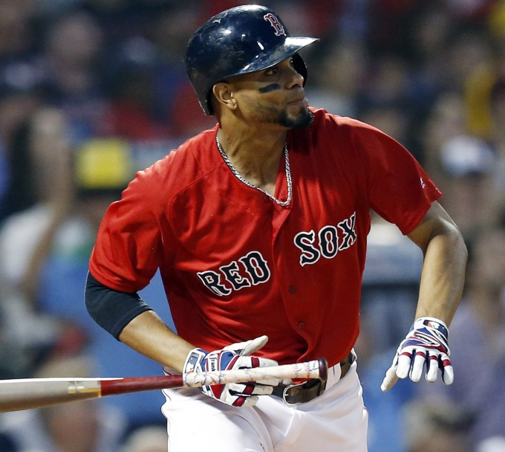 Xander Bogaerts of the Boston Red Sox watches his two-run triple Friday night during the first inning of the 7-3 victory against the Tampa Bay Rays at Fenway Park.